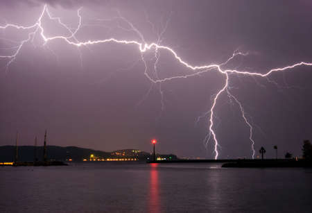 Lightning above the lake photo