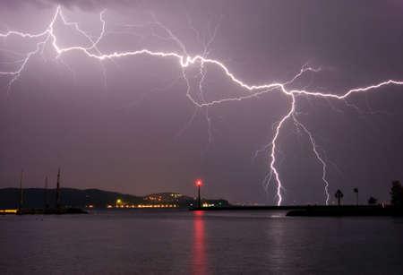 thunderstorms: Lightning above the lake Stock Photo