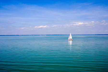Blue landscape with sailboat Stock Photo
