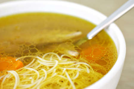 Chicken soup with noodles photo