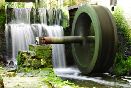 Waterwheel and waterfall photo