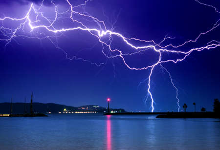 rainstorm: Lightning above the lake Stock Photo