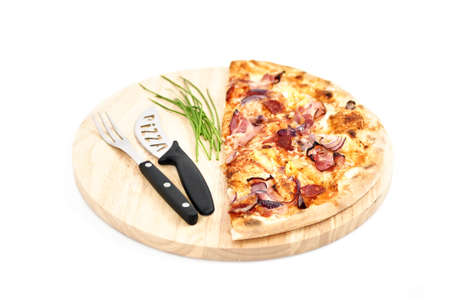 Pizza and accessories on wooden plate isolated on white Stock Photo