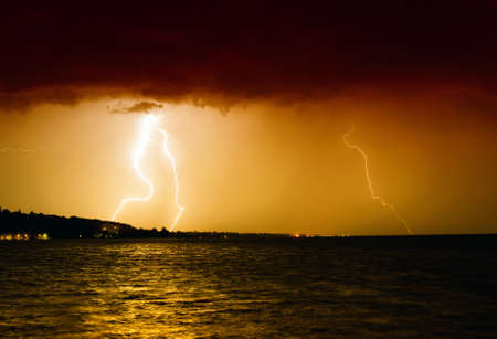 Lightning above the lake Stock Photo - 13876713