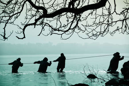 Fishermen in the water photo