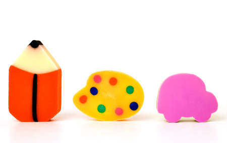Funny erasers isolated on white background photo