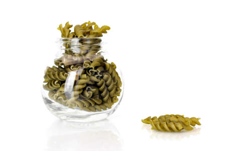 pasta isolated: Green pasta in glass dish