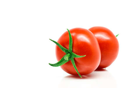 ripened: Red tomatoes isolated on white background Stock Photo