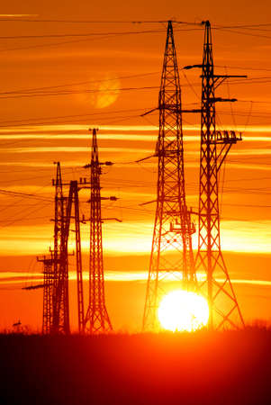 Transmission towers with sunset photo