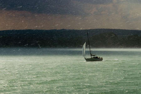 gusty: Sailboat in a rainstorm Stock Photo