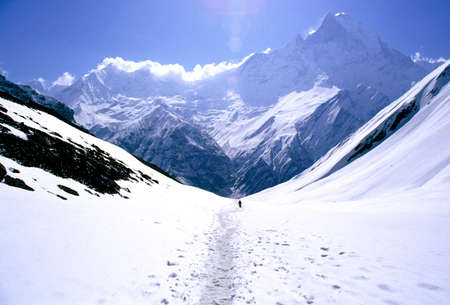 nepal: On the way to Annapurna Base Camp in Nepal, a man treks alone Stock Photo