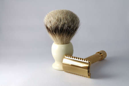 old fashioned: Gold old fashioned double edge razor with shaving badger brush Stock Photo