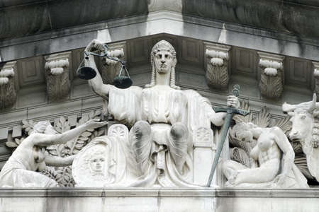 supreme court: The central figure in the tympanum is that of Justice, with a figure immediately to its left representing the lost soul begging for protection from it.  Pediment sculpture of the Old Supreme Court, City hall Singapore