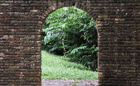 arched: Arched curved stone gateway Stock Photo