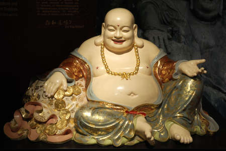 characterised: The Laughing Buddha.  Sometimes known as Budai or Angida.  He is characterised by his large belly, bald head and wide smile.