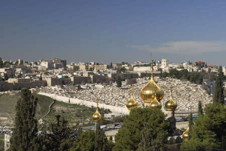 The Church of Saint Mary Magdalene.  This is a Russian Orthodox Church as seen from the Mount of Olives in Jerusalem, Israel.  Known for its golden cupolas it was build by Alexander III of Russia photo
