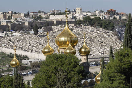 basillica: The Church of Saint Mary Magdalene.  This is a Russian Orthodox Church as seen from the Mount of Olives in Jerusalem, Israel.  Known for its golden cupolas it was build by Alexander III of Russia Stock Photo