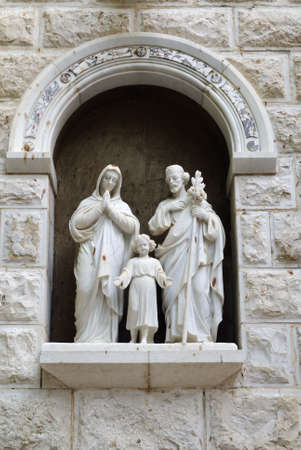st  joseph: Statue of The Holy Family, St Joseph, St Mary and the child Jesus at the entrance of St Josephs Church, Nazareth Israel