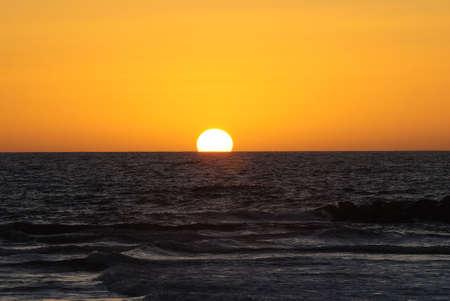 Sunset at the beach in Tel Aviv, Israel photo