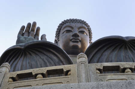 The Tian Tan Buddha is the tallest outdoor bronze seated buddha statue located on Ngong Ping, Lantau Island, Hong Kong photo
