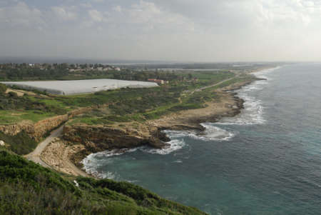 bordering: View of the coastline at the Israel bordering with Lebanon of Rosh HaNikra near the Grottoes