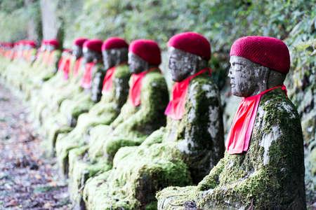 bodhisattva: Rows of Jizo  Bodhisattva  statues along the park leading to the Kanmangafuchi Abyss   This row is called Bake Jizo