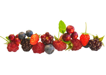 delicious fresh raspberries, blueberries, strawberries, cranberries with green leaves on a white background  photo