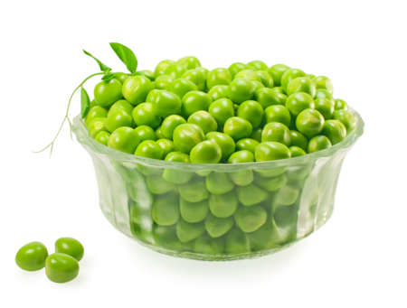 green peas in a glass, isolated on white. photo