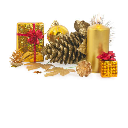Christmas composition with golden Christmas cones, candle, gift, bows and balls isolated on white. photo