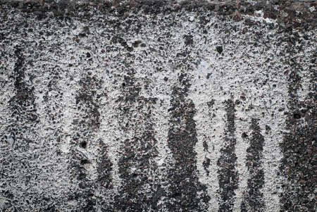 Old concrete wall with spots of paint. Grunge texture