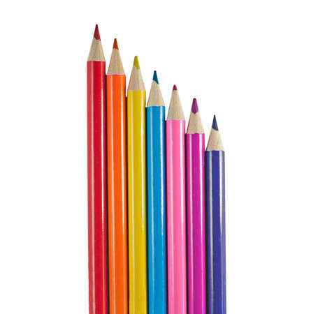 abreast: Seven Bright Colored Pencils isolated on white. Stock Photo