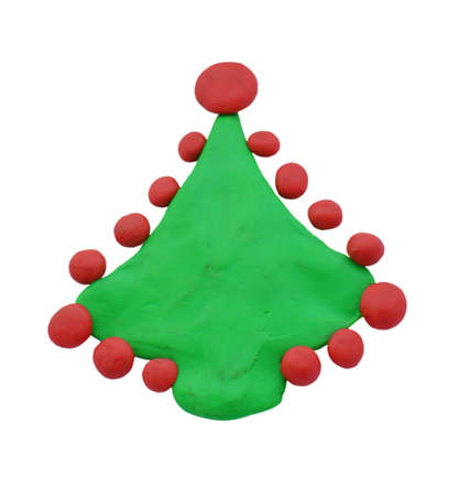 Clay Christmas spruce or pine isolated on white background. Icon of hand made plasticine tree