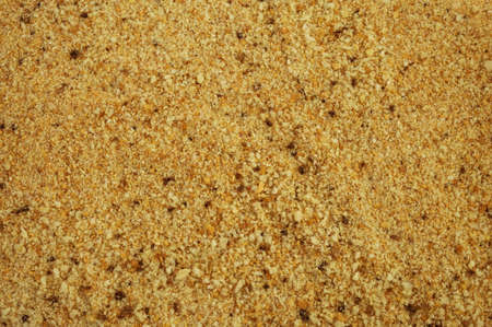 Close view of a layer of roasted bread crumbs. Breadcrumbs background