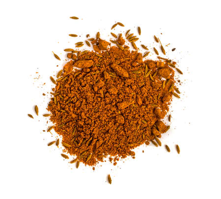 A mixture of dry ground spices. Paprika, cumin, turmeric, barberry on a white background