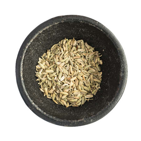 saunf: Raw Dry Fennel Seeds Heap in Black Iron Bowl Top View Closeup Isolated