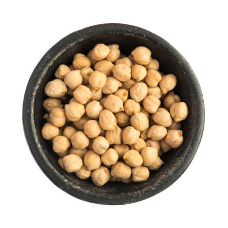 black gram: Raw Chickpea Grains Heap in Black Iron Bowl Top View Closeup Isolated