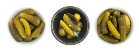 Homemade Pickled Gherkins or Cucumbers in Round Bowls. Fermented Food with Spices Isolated