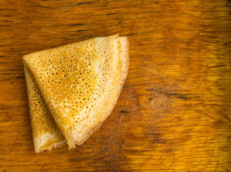 spongy: Thin Pancakes on a Wooden Background Top View. Fresh Homemade Crepes Flat Lay