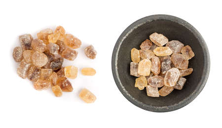 Large Crystals of Natural Unrefined Cane Sugar. Brown Lump Caramelized Saccharose on White Background
