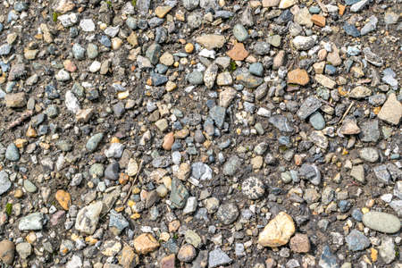 clear path: Gray and Brown Wet Gravel Road. Various Gravel Background or Texture. Small stones photography pattern