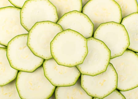 Sliced Zucchini Background. Chopped Squash Texture Top View and Flat Lay