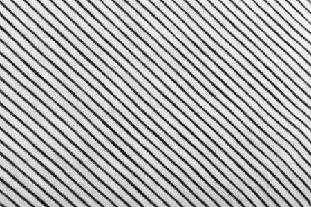 Diagonal Striped Cotton Fabric Background. Black and White Textile Pattern. Soft and Comfortable Natural Material Stock Photo