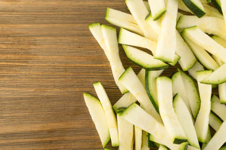 Chopped Zucchini on Wooden Background with Space for Text, Sliced Squash Top View and Flat Lay Stok Fotoğraf