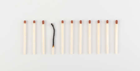 One Burned Match among Many Unburned Ones. Group of Match Sticks or Safety Matches. Individuality and Difference Concept