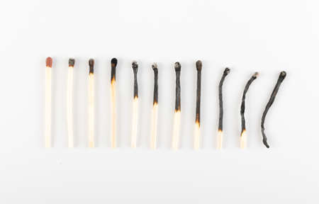 Different Stages of Match Sticks Burning or Safety Matches on White Paper. Macro Photography of Matchsticks Top View