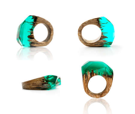 Green Ring Made of Wood and Resin. Handmade Bijouterie Isolated on White Background