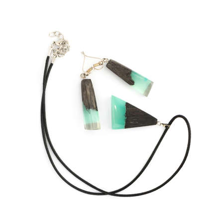 Pendant and Earrings of Turquoise Color Isolated on White Background. Bijouterie Made of Epoxy Resin and Wood 스톡 콘텐츠