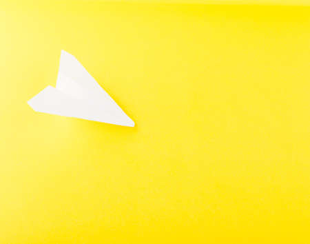 White paper plane or paper airplane origami on yellow background top foto de archivo white paper plane or paper airplane origami on yellow background top view with place for text malvernweather Images