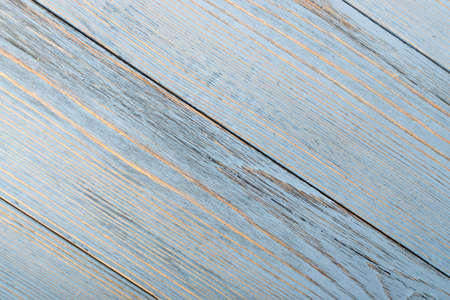 Beautiful vintage pale blue wood background. Light old painted wooden table surface. Rustic light blue pastel desk board or plank texture