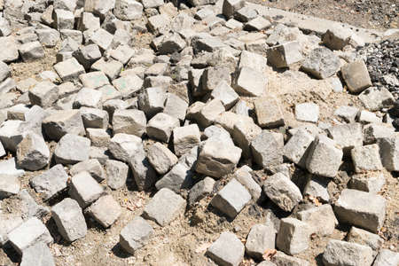 Reconstruction of Grey Old Pavement Top View or Granite Cobblestone Road. Destroyed Ancient Brick Cobblestoned Floor or Granite Tiles Street with Big Stones